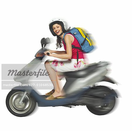 portrait of a woman on a scooter Stock Photo - Premium Royalty-Free, Image code: 627-01068530