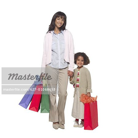 Portrait of a mother holding hands with her daughter (8-9) Stock Photo - Premium Royalty-Free, Image code: 627-01068653