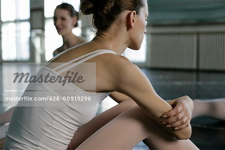 Female ballet dancers sitting on the floor