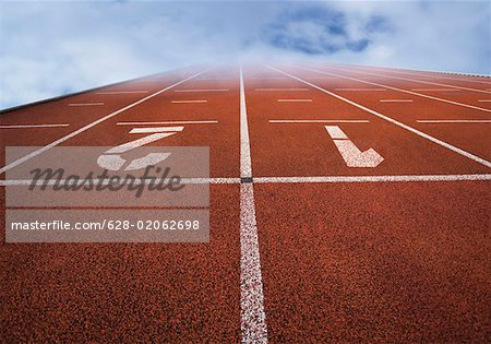 Numbered running tracks in clouds Stock Photo - Premium Royalty-Free, Image code: 628-02062698