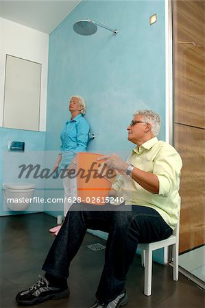 Senior couple cleaning bathroom Stock Photo - Premium Royalty-Free, Image code: 628-02615240