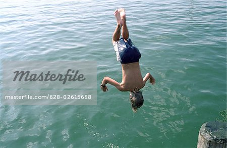 Boy jumping headlong into Water - Swimming - Leisure Time - Youth Stock Photo - Premium Royalty-Free, Image code: 628-02615688