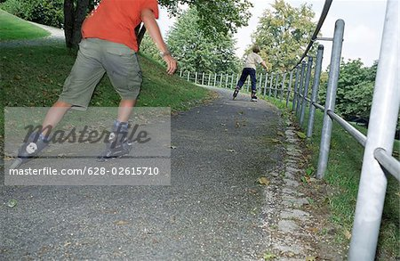 Blonde Boy rollerblading - Leisure Time - Parkway Stock Photo - Premium Royalty-Free, Image code: 628-02615710