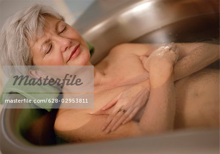Senior woman in bathtub Stock Photo - Premium Royalty-Free, Image code: 628-02953811