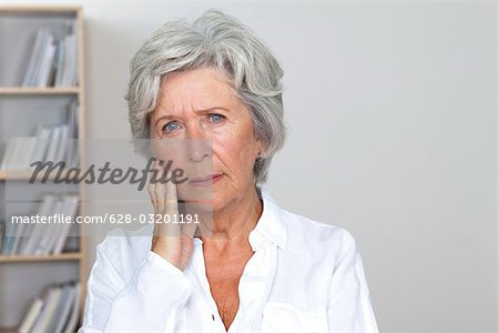 Serious senior woman Stock Photo - Premium Royalty-Free, Image code: 628-03201191