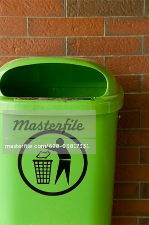 Green trash can at brick wall, Hamburg, Germany Stock Photo - Premium Royalty-Free, Image code: 628-05817331