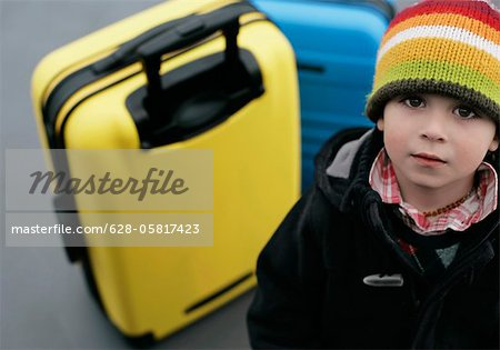 Boy looking at camera, Munich airport, Bavaria, Germany Stock Photo - Premium Royalty-Free, Image code: 628-05817423