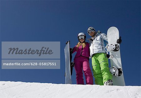 Young couple with snowboards Stock Photo - Premium Royalty-Free, Image code: 628-05817551
