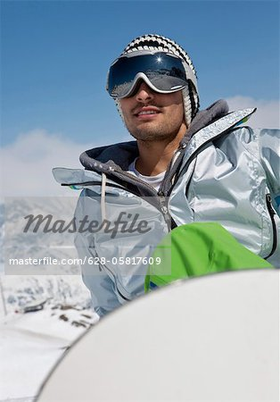 Smiling snowboarder Stock Photo - Premium Royalty-Free, Image code: 628-05817609