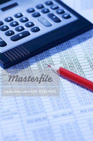 Pocket calculator and red pencil on spreadsheet Stock Photo - Premium Royalty-Free, Image code: 628-05817690