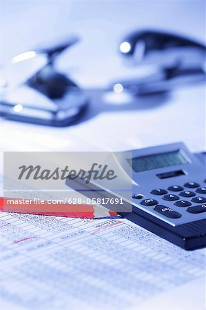 Pocket calculator and red pencil on spreadsheet Stock Photo - Premium Royalty-Free, Image code: 628-05817691