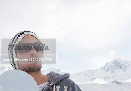 Snowboarder in winter landscape Stock Photo - Premium Royalty-Free, Image code: 628-05817748