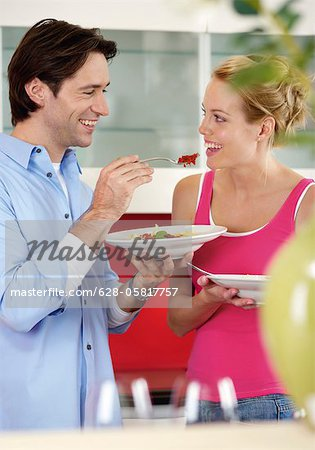 Man feeding a woman Stock Photo - Premium Royalty-Free, Image code: 628-05817757