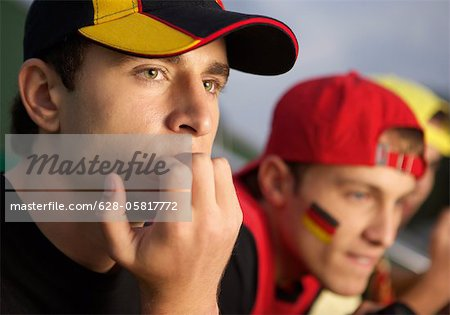 Anxious fans in a soccer stadium Stock Photo - Premium Royalty-Free, Image code: 628-05817772