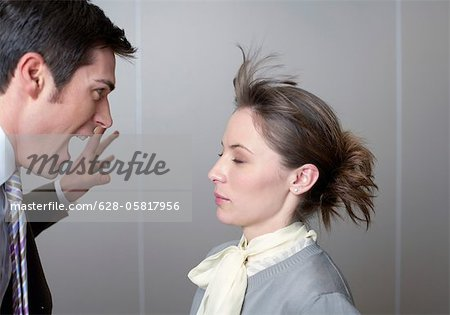 Businessman screaming at woman Stock Photo - Premium Royalty-Free, Image code: 628-05817956