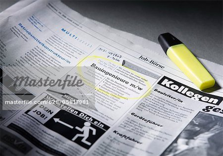 Job advertisement in newspaper marked with highlighter Stock Photo - Premium Royalty-Free, Image code: 628-05817981