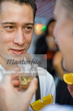 Couple drinking Tequila on the Oktoberfest in Munich, Bavaria, Germany Stock Photo - Premium Royalty-Free, Image code: 628-07072372