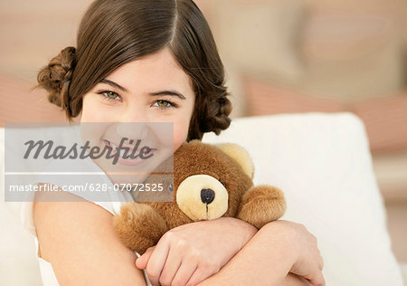 Girl hugging teddy bear Stock Photo - Premium Royalty-Free, Image code: 628-07072525