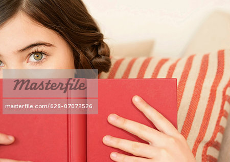 Girl holding a book Stock Photo - Premium Royalty-Free, Image code: 628-07072526
