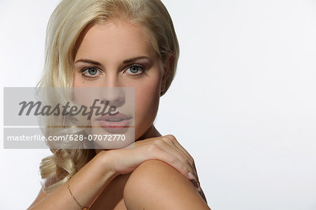 Attractive blond young woman, portrait Stock Photo - Premium Royalty-Free, Image code: 628-07072770