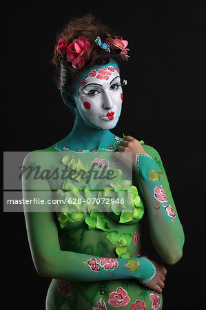 Young woman with traditional Asian body painting Stock Photo - Premium Royalty-Free, Image code: 628-07072946
