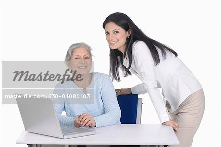 Portrait of a two businesswomen smiling Stock Photo - Premium Royalty-Free, Image code: 630-01080103