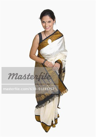 Portrait of a young woman wearing sari Stock Photo - Premium Royalty-Free, Image code: 630-01191757