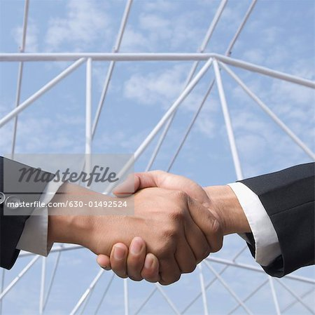 Two businessmen shaking hands Stock Photo - Premium Royalty-Free, Image code: 630-01492524