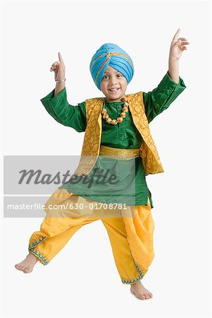 Portrait of a boy doing bhangra Stock Photo - Premium Royalty-Free, Image code: 630-01708781