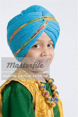Portrait of a boy smiling Stock Photo - Premium Royalty-Free, Image code: 630-01708782