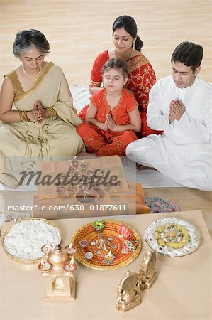 High angle view of a family doing Lakshmi pujan Stock Photo - Premium Royalty-Free, Image code: 630-01877611