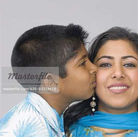 Side profile of a boy kissing his mother Stock Photo - Premium Royalty-Free, Image code: 630-02219406
