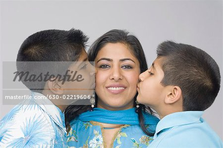 Two boys kissing their mother Stock Photo - Premium Royalty-Free, Image code: 630-02219606