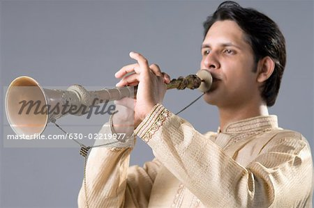 Close-up of a young man playing a clarinet Stock Photo - Premium Royalty-Free, Image code: 630-02219977