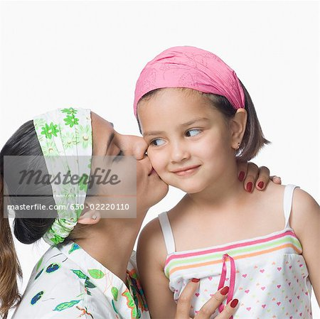 Close-up of a young woman kissing her daughter Stock Photo - Premium Royalty-Free, Image code: 630-02220110
