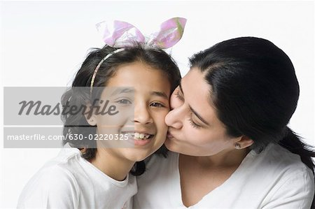 Close-up of a mid adult woman kissing her daughter Stock Photo - Premium Royalty-Free, Image code: 630-02220325
