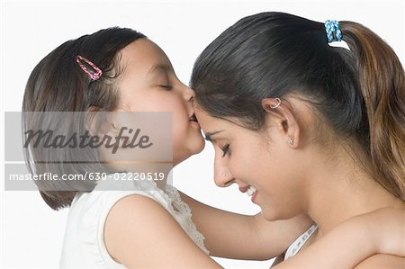 Side profile of a girl kissing her mother's forehead Stock Photo - Premium Royalty-Free, Image code: 630-02220519