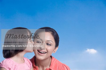 Close-up of a girl kissing her mother Stock Photo - Premium Royalty-Free, Image code: 630-02221112