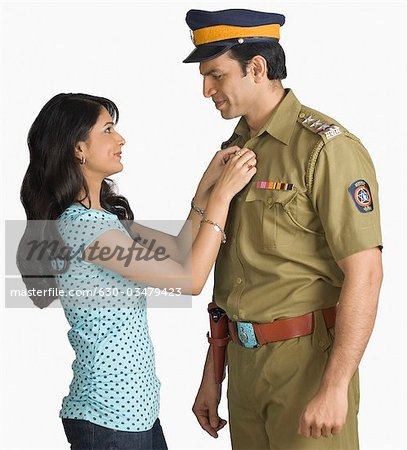 Side profile of a policeman with his wife Stock Photo - Premium Royalty-Free, Image code: 630-03479423
