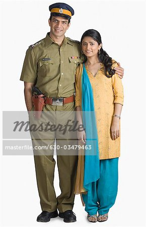 Portrait of a police officer standing with his arm around his wife Stock Photo - Premium Royalty-Free, Image code: 630-03479463