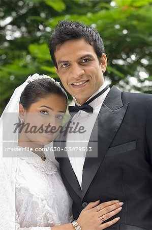 Portrait of a newlywed couple smiling Stock Photo - Premium Royalty-Free, Image code: 630-03479513