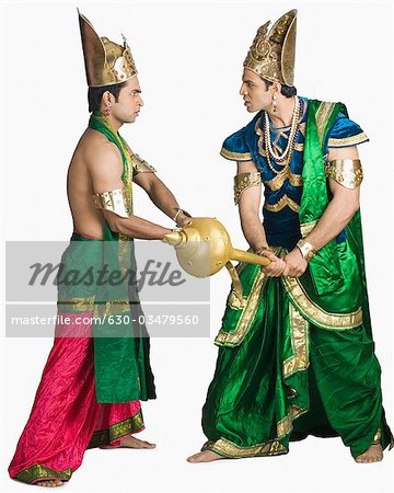 Two young men fighting in the character of Hindu epic Stock Photo - Premium Royalty-Free, Image code: 630-03479560