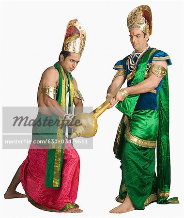 Two young men fighting in a character of Hindu epic Stock Photo - Premium Royalty-Free, Image code: 630-03479561