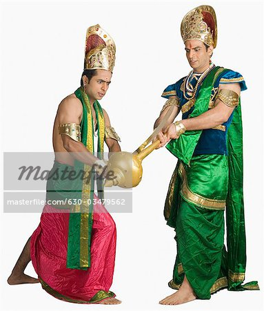 Two young men fighting in a character of Hindu epic Stock Photo - Premium Royalty-Free, Image code: 630-03479562