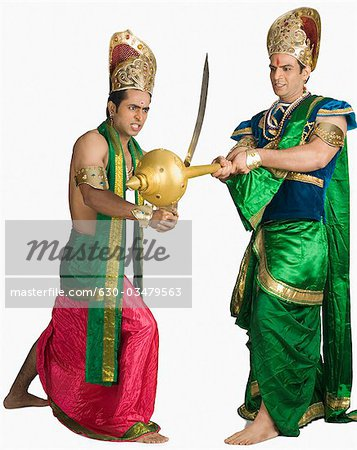 Two young men fighting in a character of Hindu epic Stock Photo - Premium Royalty-Free, Image code: 630-03479563