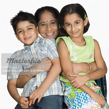 Mature woman carrying her grandchildren and smiling Stock Photo - Premium Royalty-Free, Image code: 630-03479764