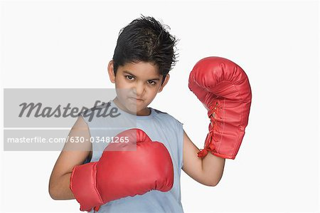Portrait of a boy wearing boxing gloves Stock Photo - Premium Royalty-Free, Image code: 630-03481265