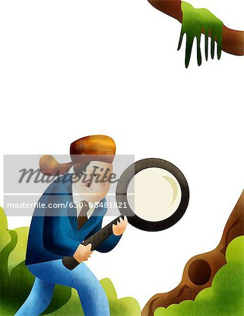 Man on a job hunt with a magnifying glass Stock Photo - Premium Royalty-Free, Image code: 630-03481821