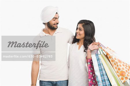 Couple standing together and smiling Stock Photo - Premium Royalty-Free, Image code: 630-03482783