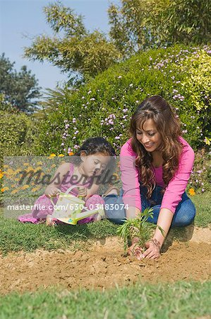 Woman planting with her daughter Stock Photo - Premium Royalty-Free, Image code: 630-03483074